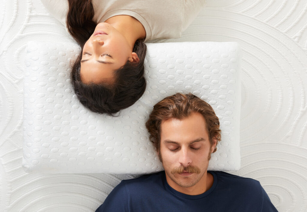 Two people sleeping on the Infinity Cool Pillow